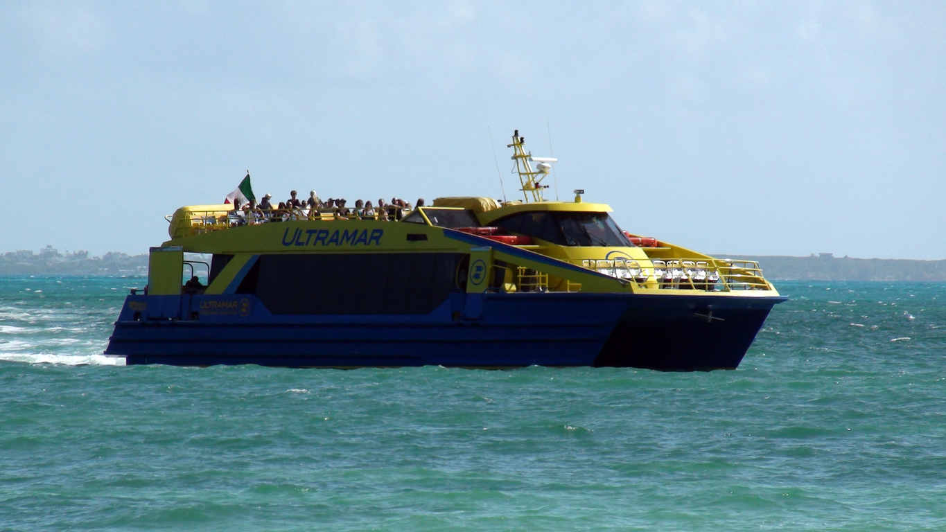 Isla Mujeres Island Sea Including People Sitting Down Inside Ultramar Ferry Scenery In Quintana Roo Mexico